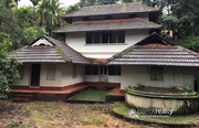 Old Traditional triple story house with 1.30 acre land near panamaram